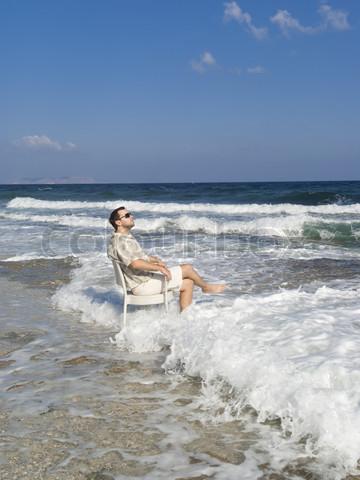 Summer vacation: Happy man near sea