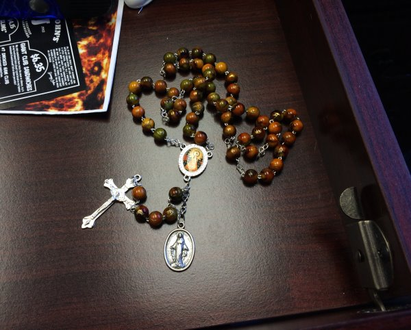 The rosary in my top office desk drawer.