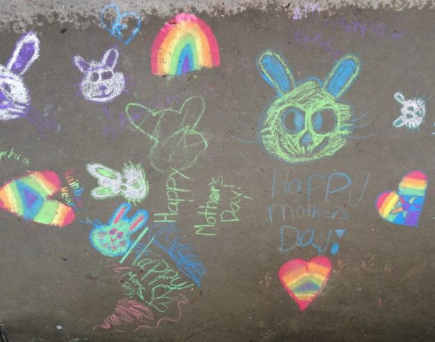Our team's little sister's Mother's Day chalk art left behind their big brother's dugout during the semifinals.